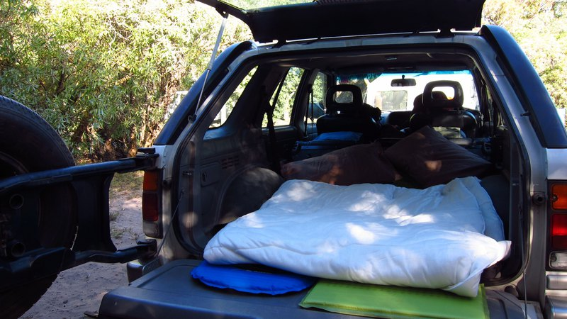 camp setup in back of offroad vehicle